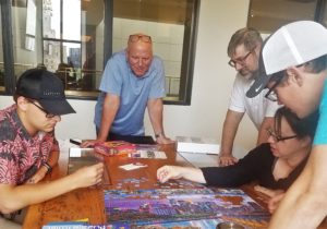 A color photo of staff at the downtown Minneapolis office of Landform Professional Services LLC working together to put a puzzle together. This was shared by Minneapolis Minnesota company Landform Professional Services that offers: Landscape Design, Landscape Architecture, Urban Planning, Urban Design, Civil Engineer, Drone Operator, Landscape Designer Civil Engineering, Land Surveying and drone/aerial operations for small, medium and large businesses and residences throughout the USA. You can contact Landform at www.landform.net.